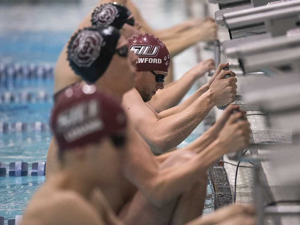 Junior Alex Crawford braces before the start of the 200-yard backstroke race Saturday, Dec. 3, 2016, during the Saluki men's team's 195-93 loss to Missouri State at Edward J. Shea Natatorium. Crawford finished in fourth place with a time of 1:53.84. (Morgan Timms | @Morgan_Timms)