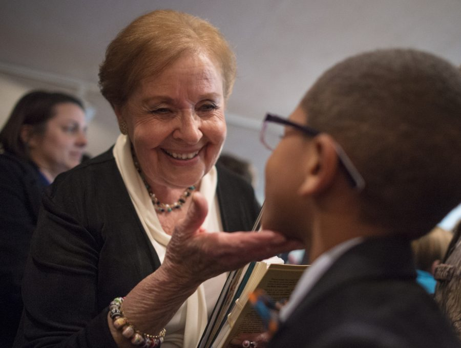 Holocaust survivor Marion Blumenthal Lazan greets Zion Henry, 7, of Carbondale, following her speech Tuesday, Dec. 6, 2016, at the First United Methodist Church in Carbondale. Lazan, who immigrated to the United States with her family in 1948, told the story of her journey as a Jewish child in Nazi controlled Germany and at Bergen-Belsen, a concentration camp in Germany where she and her family were imprisoned.