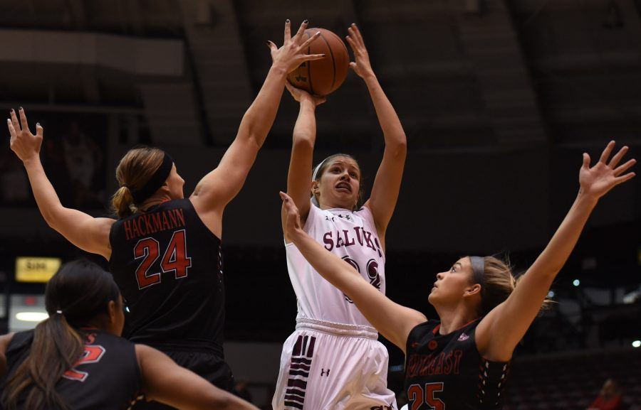 Junior guard Kylie Giebelhausen (32) attempts a shot while being guarded by SEMO senior guard/forward Olivia Hackmann (24) and junior guard Hannah Noe (25) during the Salukis' 77-70 win Friday, Dec. 9, 2016, against the Redhawks at SIU Arena. (Bill Lukitsch | @lukitsbill)