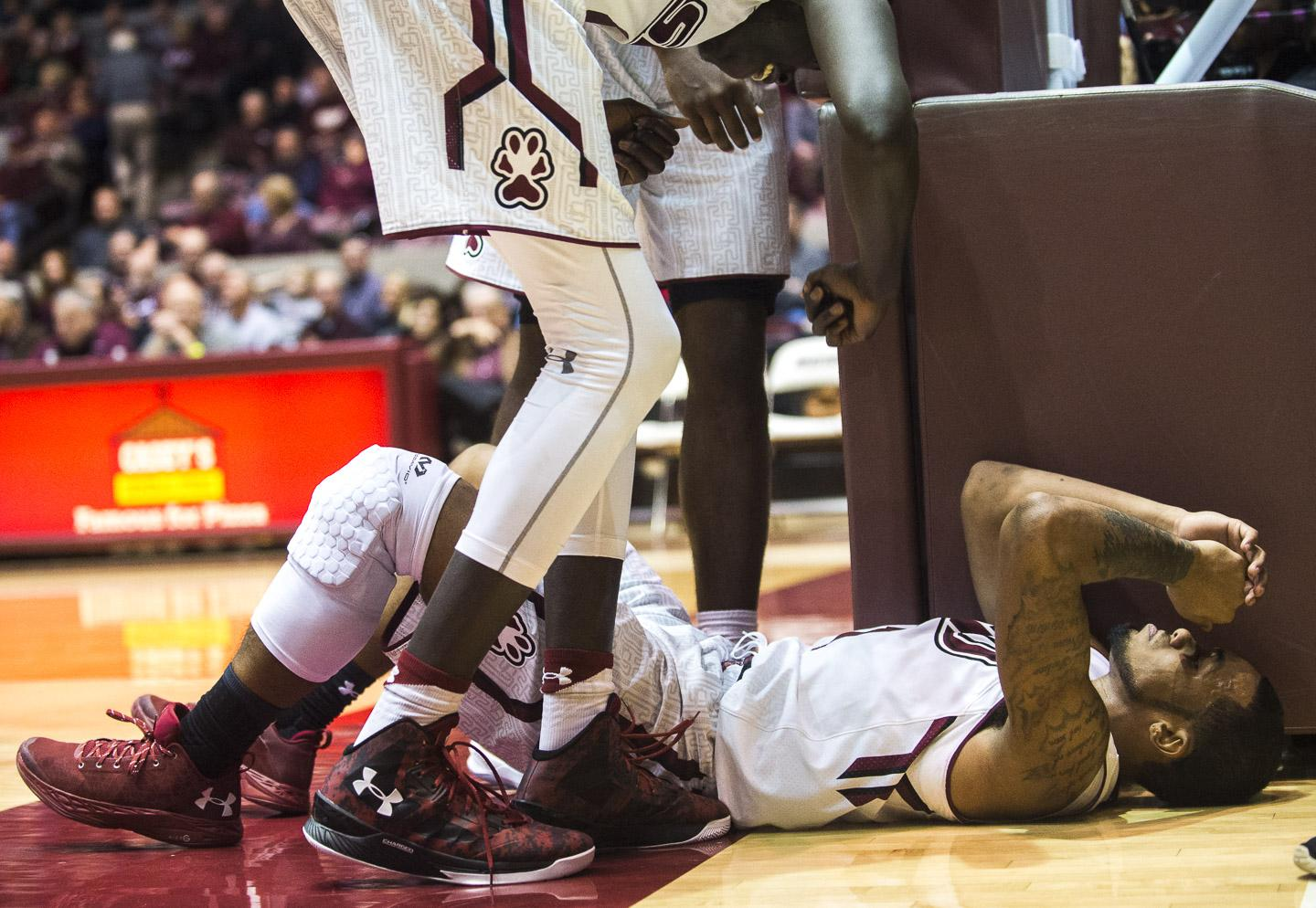Senior guard Mike Rodriguez recovers from a fall during the Salukis' 70-55 win against Saint Louis University on Wednesday, Dec. 14, 2016, at SIU Arena. (Ryan Michalesko | @photosbylesko)
