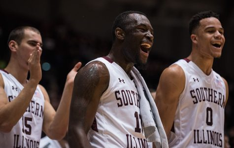 From left: sophomore forward Austin Weiher, sophomore guard Sean Lloyd and junior guard Jonathan Wiley react to a play near the conclusion of SIU's 78-70 victory against UT-Martin on Thursday, Dec. 22, 2016, at SIU Arena. (Jacob Wiegand | @jawiegandphoto)