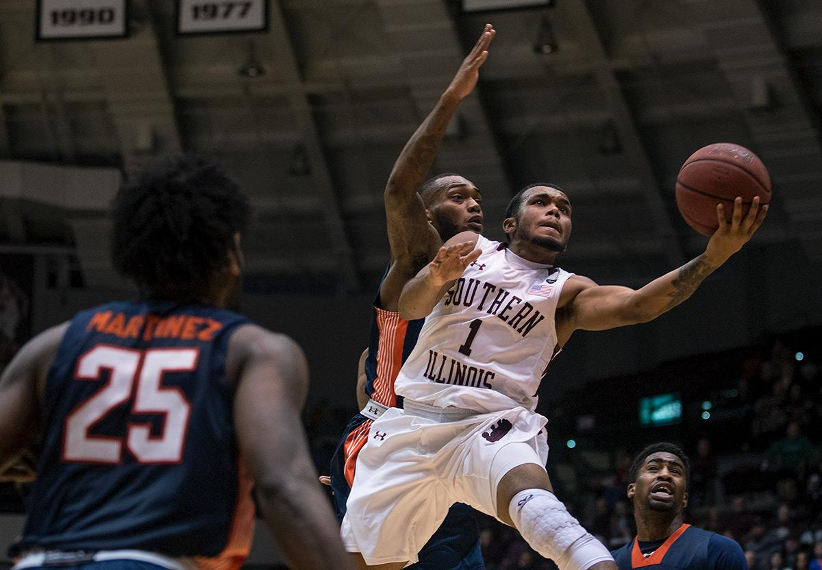 Senior guard Mike Rodriguez attempts a basket during SIU's 78-70 victory against UT-Martin on Thursday, Dec. 22, 2016, at SIU Arena. (Jacob Wiegand | @jawiegandphoto)