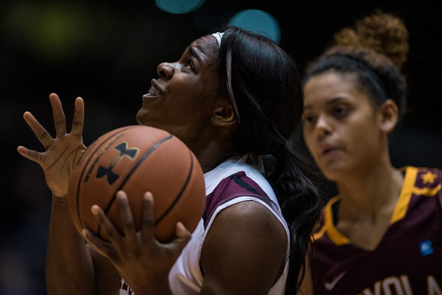 Senior forward Kim Nebo looks up toward the goal during SIU's 73-57 victory against the Loyola Ramblers on Friday, Dec. 30, 2016, at SIU Arena. Nebo scored 10 points in the game. (Jacob Wiegand | jawiegandphoto)