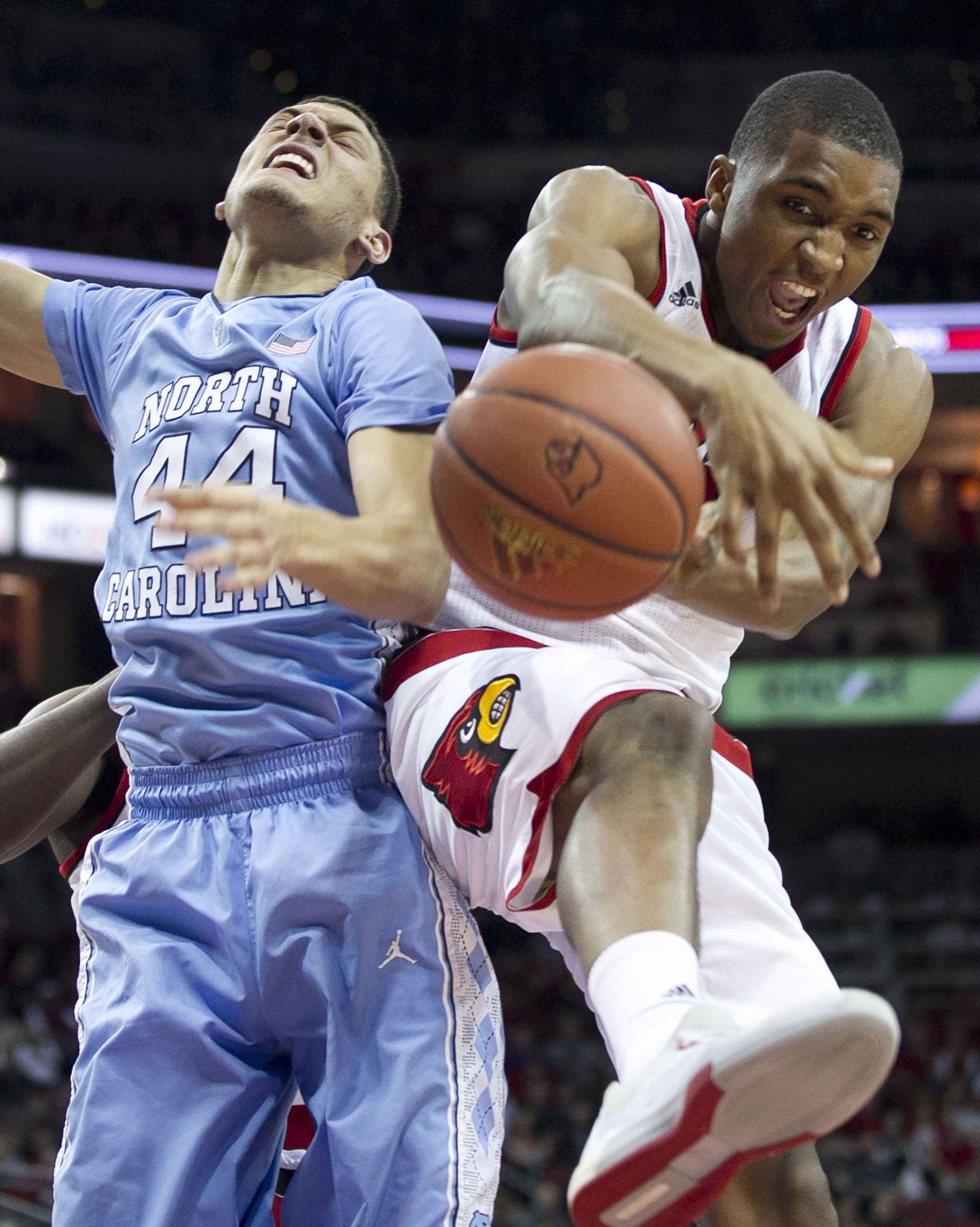 Louisville's Donovan Mitchell (45) secures a defensive rebound from North Carolina's Justin Jackson (44) during the second half on Monday, Feb. 1, 2016, at the KFC Yum! Center in Louisville, Ky. (Robert Willett/Raleigh News & Observer/TNS)
