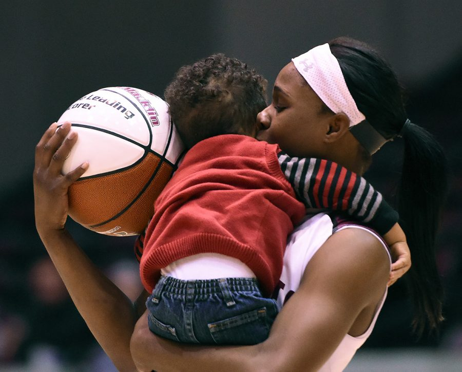 Senior guard Cartaesha Macklin kisses her son, Carson Verhines, who will turn 2 in April, after SIU's 74-56 win against Evansville on Jan. 16 at SIU Arena. During the game, Macklin became the top scorer in Saluki women's basketball history, beating Amy Rakers' record of 1,538 career points. (Jacob Wiegand | @jawiegandphoto)