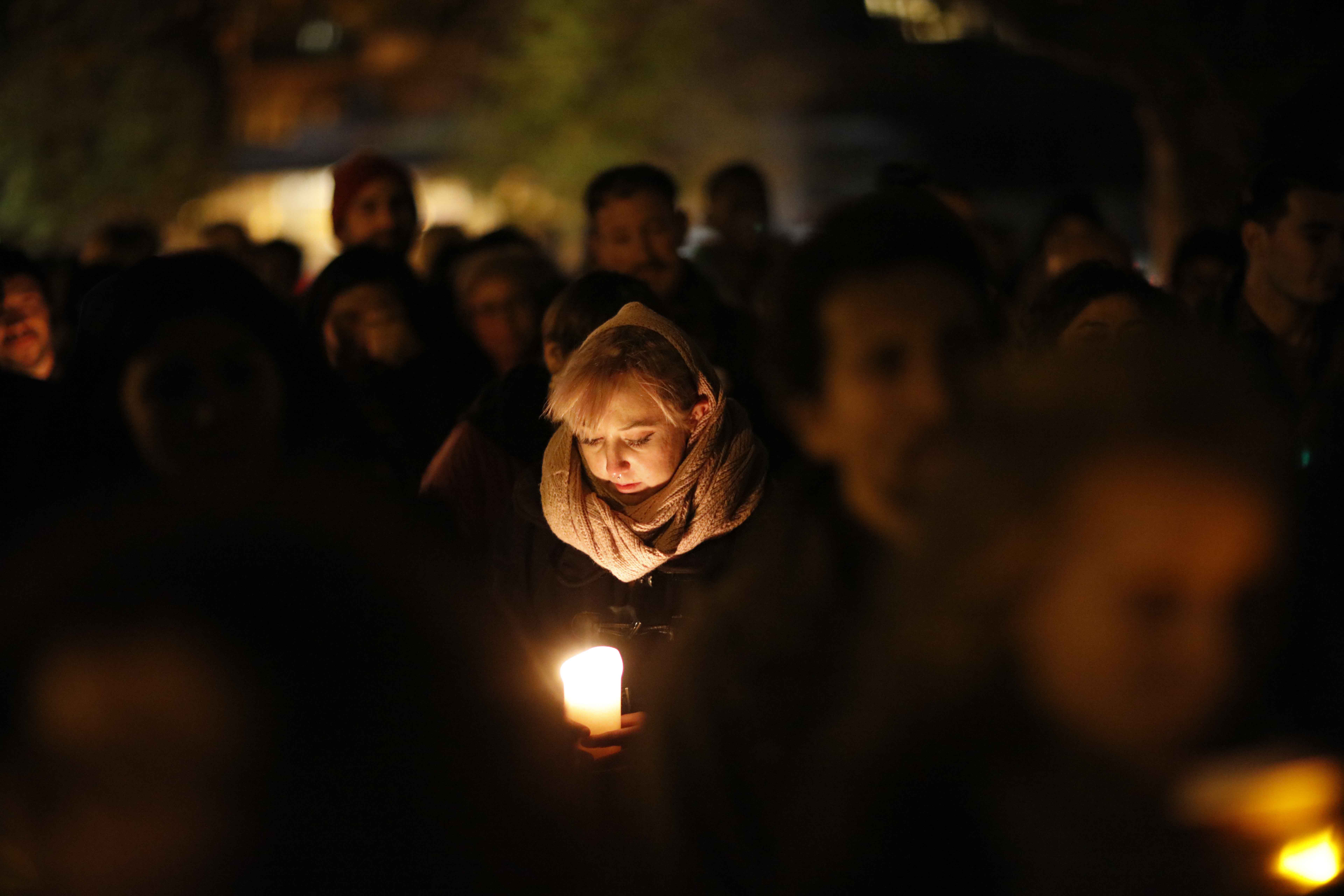 A vigil is held at Lake Merritt for the victims of the