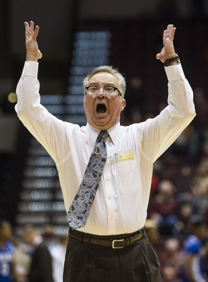 Coach Barry Hinson attempts to excite the fans during the Salukis' 83-69 win against the Drake Bulldogs on Sunday, Jan. 1, 2017, at SIU Arena. (Ryan Michalesko | @photosbylesko)