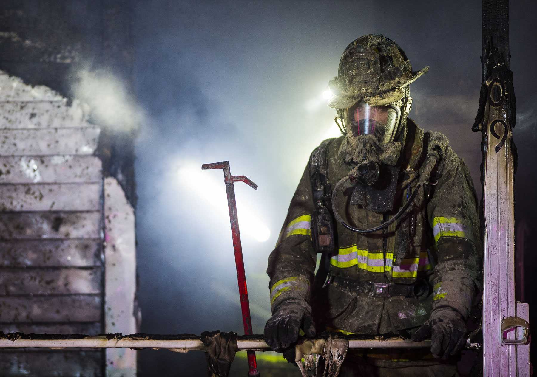 A firefighter works to battle a residential structure fire in the 400 block of East James and Thelma Walker Avenue on Wednesday, Jan. 4, 2017, in Carbondale. There were no injuries, but the home is considered a total loss, Assistant Fire Chief Steve McBride said. The cause of the fire is still under investigation. (Ryan Michalesko | @photosbylesko)