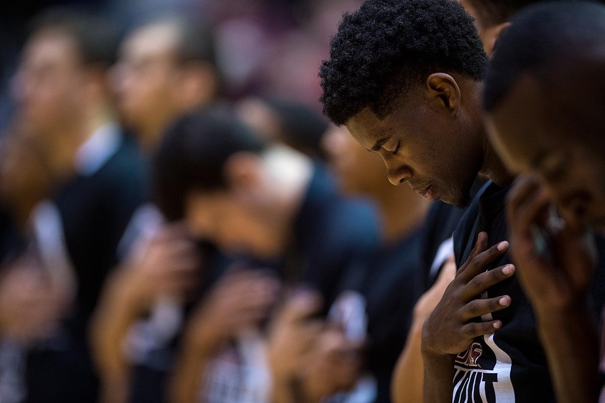 Saluki sophomore guard Armon Fletcher bows his head during the singing of the national anthem prior to the start of SIU's 60-53 loss to the Illinois State Redbirds on Wednesday, Jan. 11, 2017, at SIU Arena. Fletcher scored 12 points in the game. (Jacob Wiegand | @jawiegandphoto)
