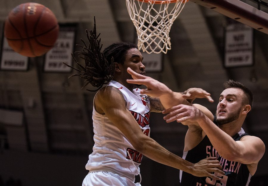 Saluki senior forward Sean O'Brien passes the ball by Illinois State senior guard Tony Wills during SIU's 60-53 loss to the Redbirds on Wednesday, Jan. 11, 2017, at SIU Arena. O'Brien scored a team-high 15 points in the game. (Jacob Wiegand | @jawiegandphoto)