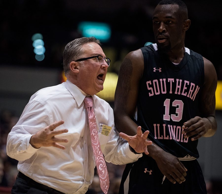 Coach Barry Hinson yells while standing next to sophomore guard Sean Lloyd during SIU's 60-53 loss to the Redbirds on Wednesday, Jan. 11, 2017, at SIU Arena. (Jacob Wiegand | @jawiegandphoto)
