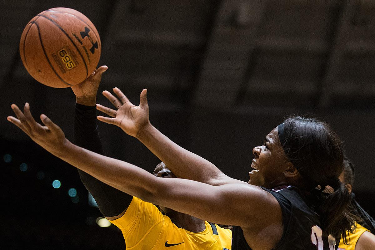 Saluki senior forward Kim Nebo and Shocker senior guard TaQuandra Mike reach for the ball during SIU's 77-54 win against Wichita State on Friday, Jan. 13, 2017, at SIU Arena. Nebo scored 16 points in the game and had 10 rebounds. (Jacob Wiegand | @jawiegandphoto)