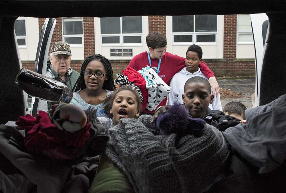 "Counterclockwise from left: Good Samaritan Ministries Executive Director Mike Heath supervises Aniyah Miller, 10; Carissa Bennett, 10; Jaden Garnette-Love, 10; Darren Johnson, 10, all of Carbondale; and Zachary Myers, of Memphis, Tenn., as they fill Heath's trunk with blankets, hats and gloves donated by the public Monday during the Boys and Girls Club of Carbondale's Lend a Hand donation drive. The children held the drive for their annual Martin Luther King Jr. Day of Service project. The Carbondale community was invited to drop off fresh fruits and vegetables, spare change, warm blankets, hats and gloves at the Boys and Girls Club, where they were later presented to Heath and Good Samaritan vice president Maurine Pyle. ""This is fantastic,"" Heath said of the drive. ""This is our life bread, especially at this time of year when it's cold."" Although the state's stopgap budget provided Good Samaritan with enough resources for 2016 and 2017, Heath said without a real budget, the organization faces financial uncertainty beyond then. ""We have tremendously generous donors here in town,"" Pyle said. ""All of these local donors and fundraisers keep us going. It's a community of philanthropy."""
