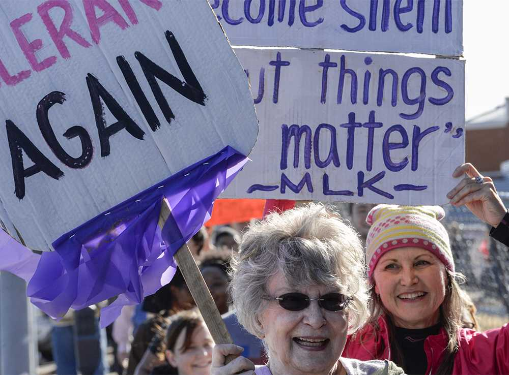 Carolyn+Taylor%2C+of+Carbondale%2C+left%2C+marches+ahead+of+her+daughter%2C+Sheree+Swanson%2C+of+Carbondale%2C+on+Saturday%2C+Jan.+21%2C+2017%2C+during+the+Southern+Illinois+Women%27s+March+in+Carbondale.+%22We+are+here+because+we+feel+we+have+to+stand+up+for+all+the+people+who+are+discriminated+against%2C%22+Swanson+said.+Taylor+and+Swanson%27s+signs+read%2C+%22Make+America+tolerant+again%2C%22+and+%22Our+lives+begin+to+end+the+day+we+are+silent+about+things+that+matter.%22+%28Morgan+Timms+%7C+%40Morgan_Timms%29