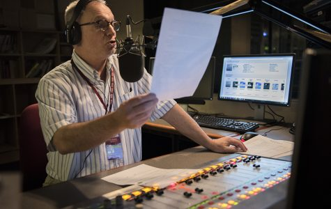 WSIU Radio reporter Kevin Boucher, of Murphysboro, reads local and state news headlines Monday, Jan. 23, 2017, during the daily newscast for WSIU in the radio studio of the Communications Building. An SIU alumnus, Boucher has been around SIU's radio department since 1976.