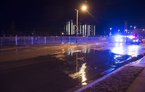 Water fills the road Tuesday, Jan. 31, 2017, after a water main break on South Wall Street between East Grand Avenue and East Park Street. (Athena Chrysanthou | @Chrysant1Athena)