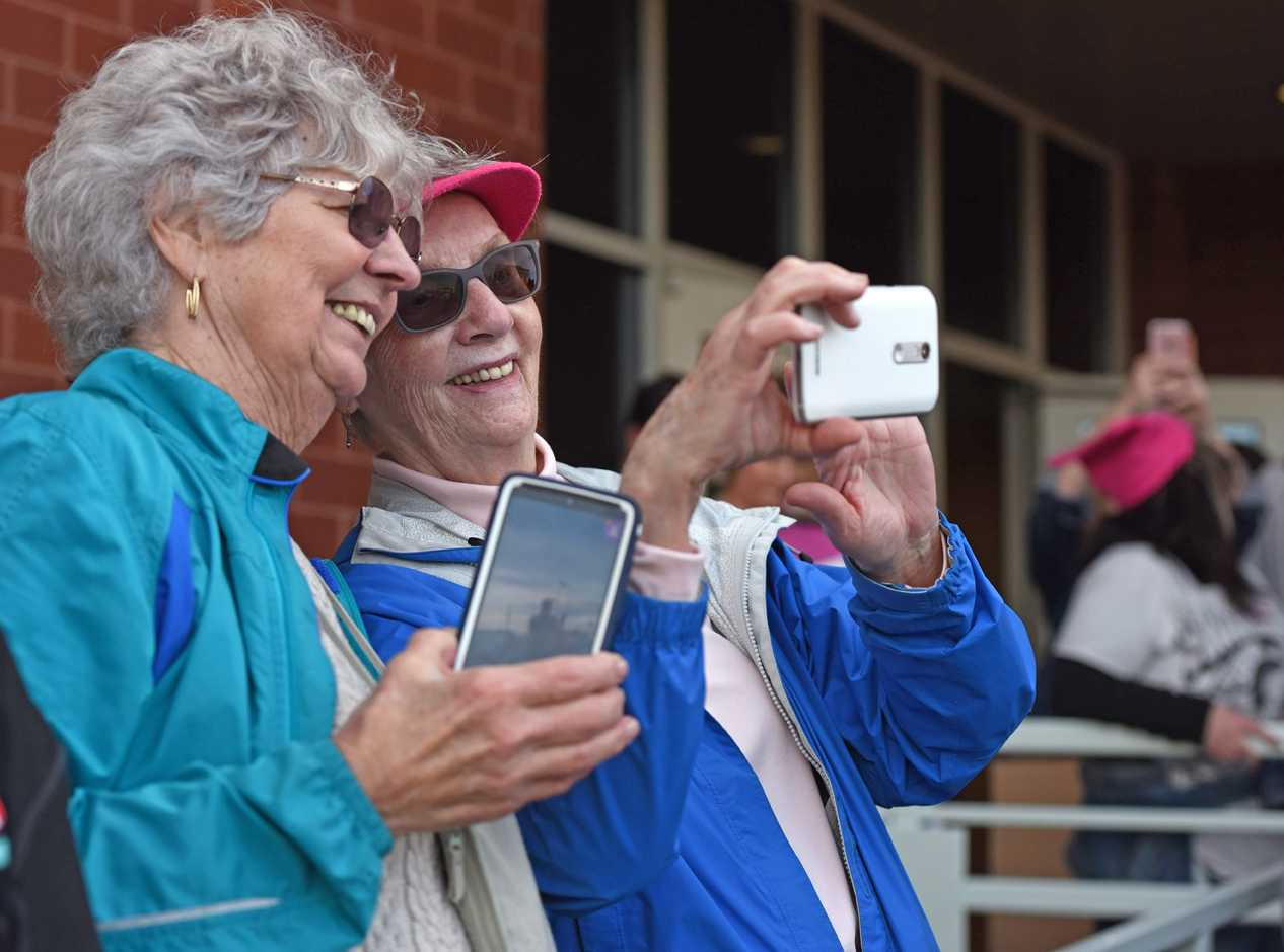 Pat+Grimmer%2C+a+retired+Carbondale+Community+High+School+teacher%2C+smiles+as+Esther+Hays%2C+of+Carbondale%2C+uses+her+phone+to+take+a+selfie+near+the+end+of+the+Southern+Illinois+Women%27s+March+on+Saturday%2C+Jan.+21%2C+2017%2C+in+front+of+the+Carbondale+Civic+Center.+%22I+feel+a+lot+more+positive+after+being+here+today+instead+of+overwhelmed+with+all+the+negative+feelings%2C%22+Hays+said.+Grimmer%2C+who+held+a+sign+with+an+image+of+the+former+first+family%2C+said+she+has+also+participated+in+anti-war+protests+in+Carbondale.+%28Anna+Spoerre+%7C+%40annaspoerre%29