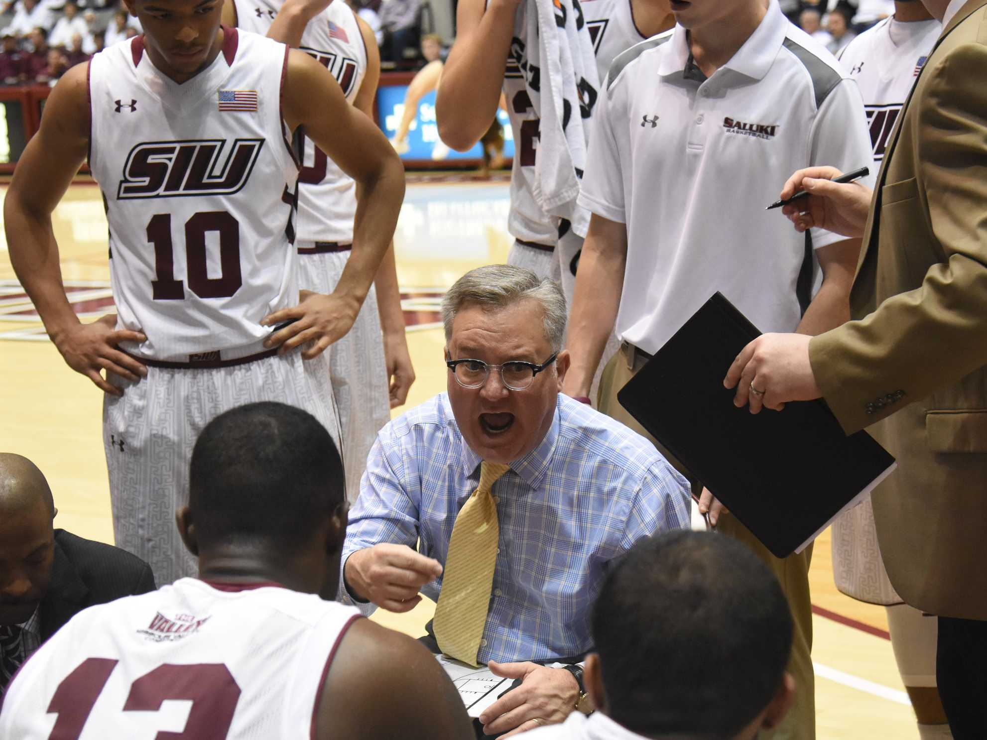 Coach Barry Hinson talks to his players Saturday, Jan. 21, 2017, during SIU's 58-57 loss against the Northern Iowa Panthers at SIU Arena. (Luke Nozicka | @lukenozicka)