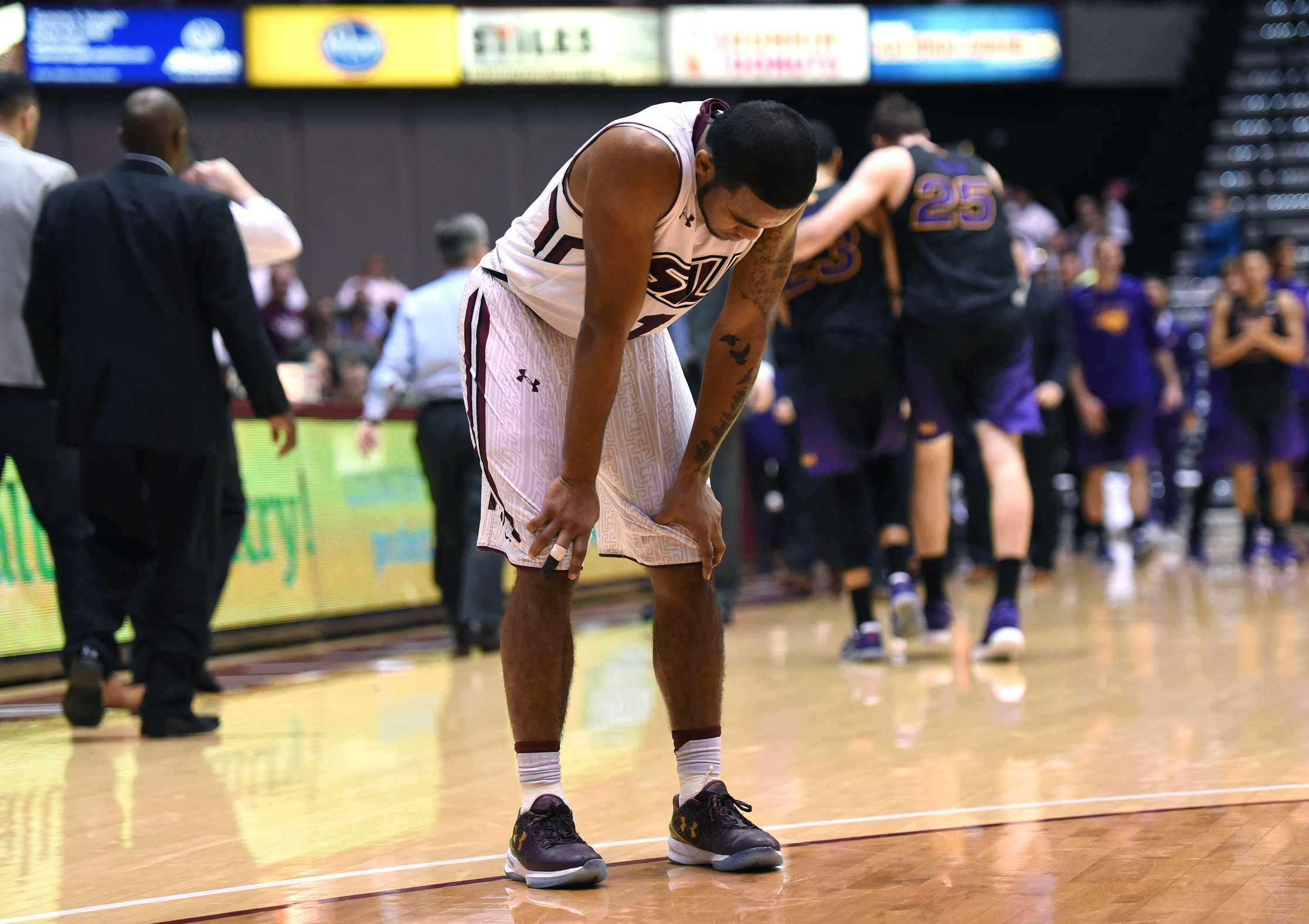 Senior guard Mike Rodriguez leans over after SIU's 58-57 loss against the Northern Iowa Panthers on Saturday, Jan. 21, 2017, at SIU Arena. (Luke Nozicka | @lukenozicka)