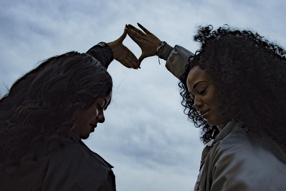 """Charmonique Rogers, a senior from Chicago studying psychology and Aesha Mathis, a senior from Chicago studying radio, television and digital media, make """"The Door"""" hand sign representing Delta Phi Delta Dance Fraternity on Wednesday, Jan. 18, 2017, outside of the Student Center in celebration of the organization's founder's day. Mathis, the SIU chapter president, said it was founded on Jan. 18, 2000, and has chapters at universities across the midwest and south. """"The whole organization is motivated by dance, but we are more than a dance team,"""" Mathis said. """"We are sharing a passion."""" In addition to dancing, the group participates in community service and collaborates with other greek organizations. Students interested in joining can attend an informational meeting at 6:22 p.m. Tuesday in the Student Center Delta Room. (Branda Mitchell   @Branda_Mitchell)"""