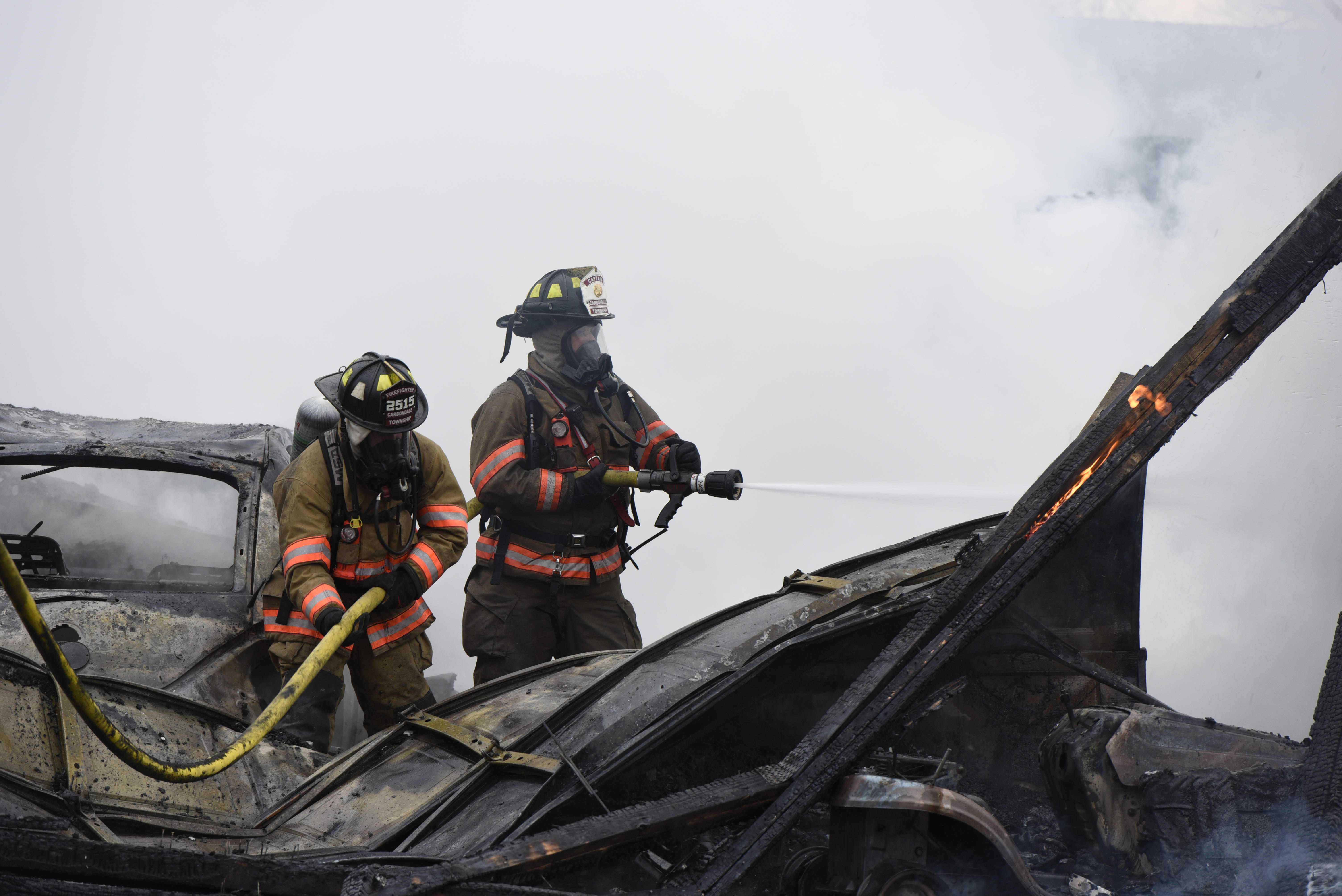Firefighters extinguish remaining flames of a destroyed garage Wednesday, Feb. 1, 2017, after a fire near the intersection of Kennedy and Union Hill roads. (Bill Lukitsch | @lukitsbill)