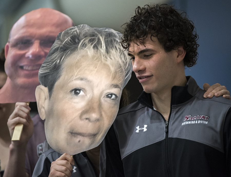 Filippo Dell'olio, a senior from Usmate, Italy, stands with a cardboard cutout of his mother, Sondra, on Saturday, Feb. 4, 2017, during a ceremony honoring seniors on the SIU swimming and diving team at Edward J. Shea Natatorium. (Morgan Timms   @Morgan_Timms)