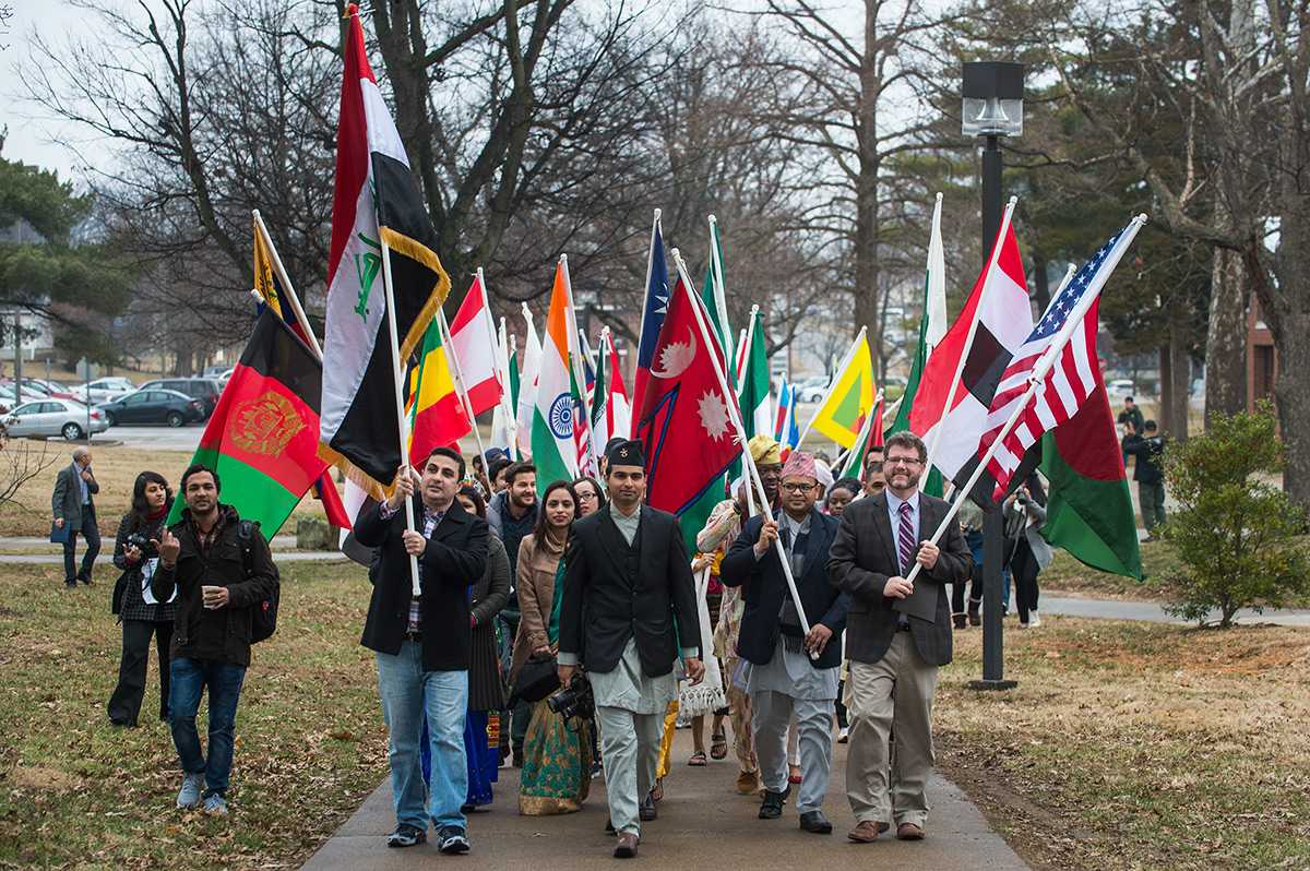Marchers walk in the International Parade of Flags on Monday, Feb. 6, 2017, from Woody Hall to the Student Center. The parade was the kickoff event of International Festival 2017 at SIU. (Jacob Wiegand | @jawiegandphoto)