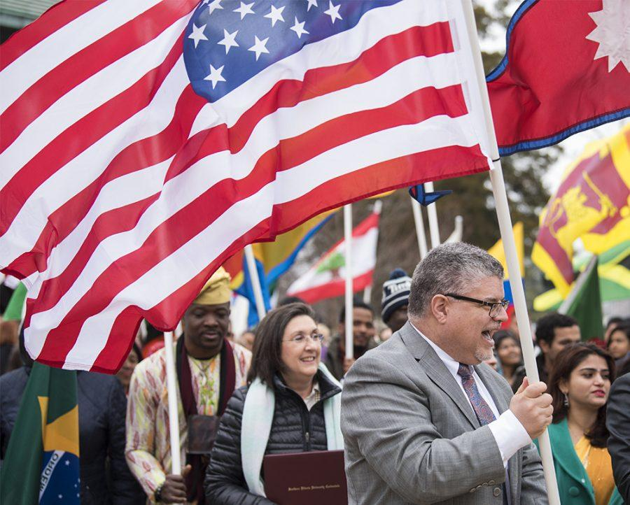 Interim Chancellor Brad Colwell leads students on Monday, Feb. 6, 2017, during the International Parade of Flags from Woody Hall to the Student Center. (Morgan Timms   @Morgan_Timms)