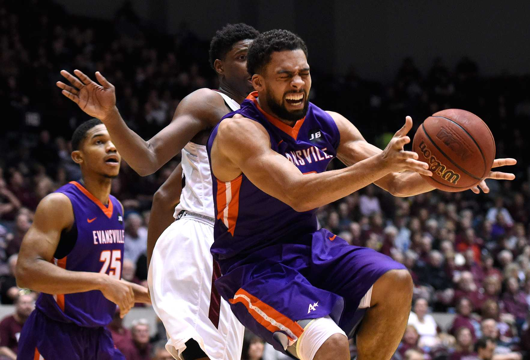 Evansville senior guard Christian Benzon reaches for the ball Saturday, Feb. 11, 2017, during the Purple Aces' 75-70 win over the Salukis at SIU Arena. (Luke Nozicka | @lukenozicka)