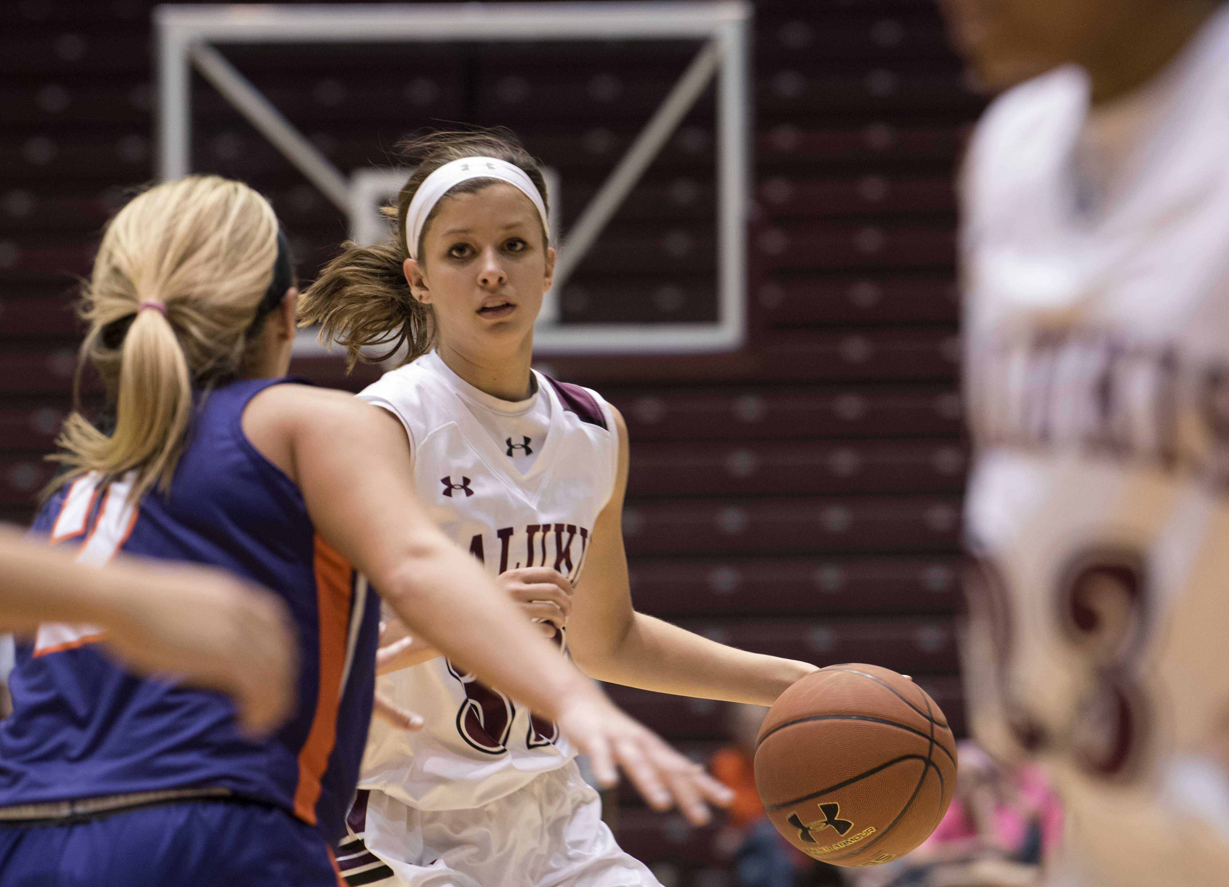 Junior guard Kylie Giebelhausen is guarded by Aces sophomore forward Kerri Gasper on Friday, Feb. 17, 2017, during a game against the Evansville Aces at SIU Arena. The Salukis lost to the Evansville Aces 74-61. (Bill Lukitsch | @lukitsbill)