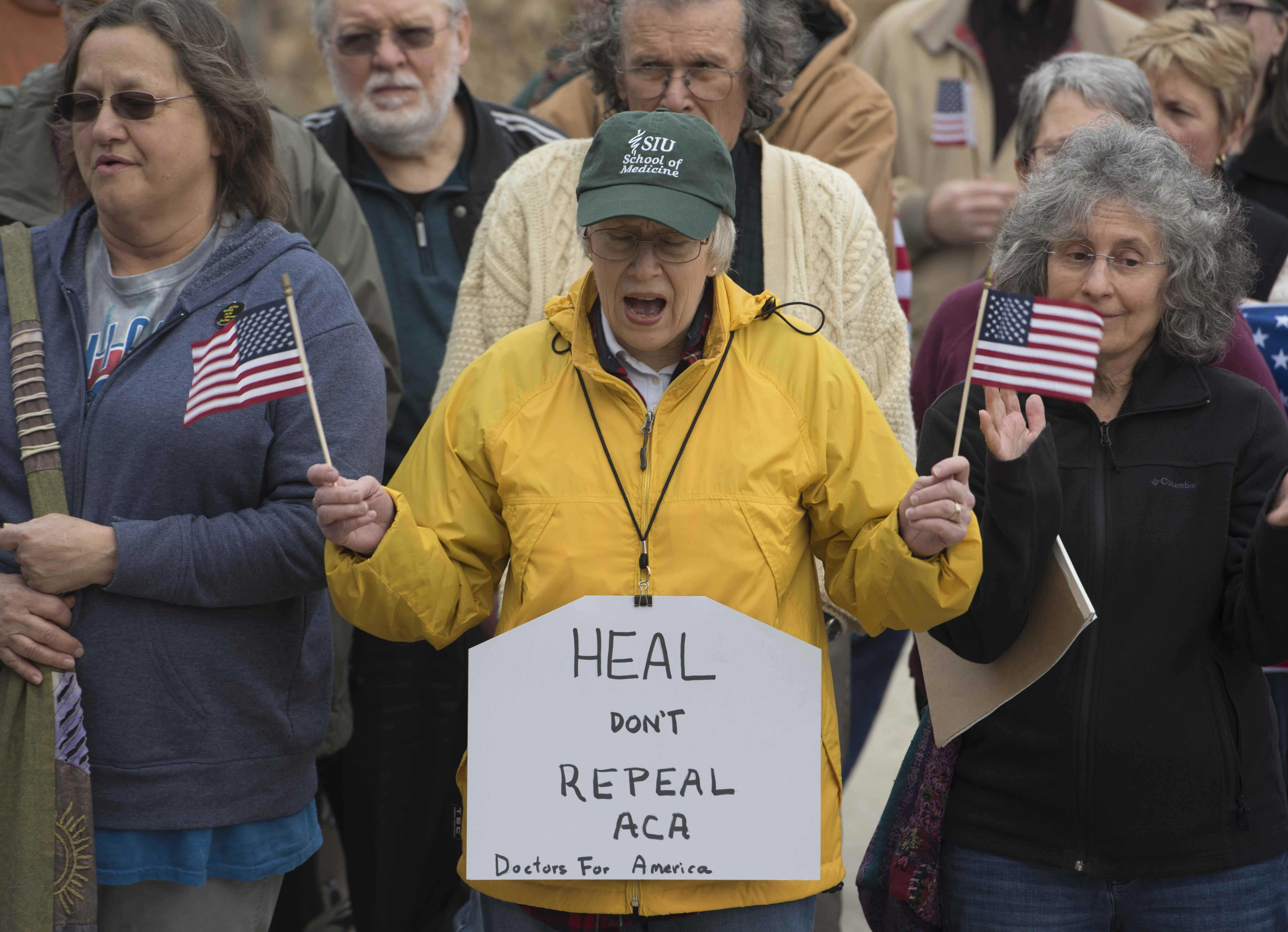 Protesters gathered at the office of Republican Rep. Mike Bost on Tuesday, Feb. 21, 2017,  to demand he support the Affordable Care Act. Bost twice voted to repeal the act while former President Barack Obama was in office and has said he supports an alternative approach to providing health care for Americans. (Bill Lukitsch | @lukitsbill)