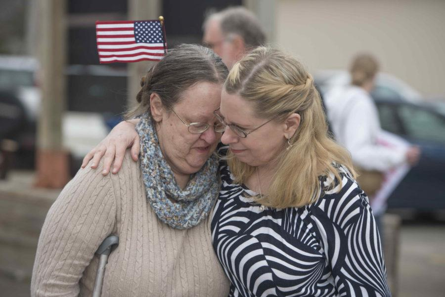 Two women embrace Tuesday, Feb. 21, 2017, at a demonstration in front of Rep. Mike Bost's Carbondale office.  The protestors arrived to demand Bost support the Affordable Care Act, which he has twice voted to repeal. (Bill Lukitsch | @lukitsbill) `