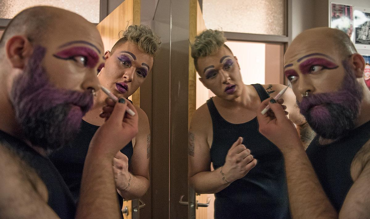 "Greg Hummel and Alex Davenport, both doctoral students in communication studies from Ashland, Pennsylvania and Sterling, Virginia respectively, prepare their makeup before going onstage for a rehearsal of ""In Service of Venus"" on Wednesday, Feb. 22, 2017, in the Marion Kleinau Theatre in the Communications Building. ""[The production] deals with love, it deals with dating in the online world, it deals with working in the service industry and finding connections between those things,"" said Anna Wilcoxen, who wrote, performed in and co-directed the production. She said the play is ""more of a psychological show"" as opposed to a linear narrative. The play can been viewed at 8 p.m. Feb. 23, 24 and 25 in the Marion Kleinau Theatre. (Jacob Wiegand 