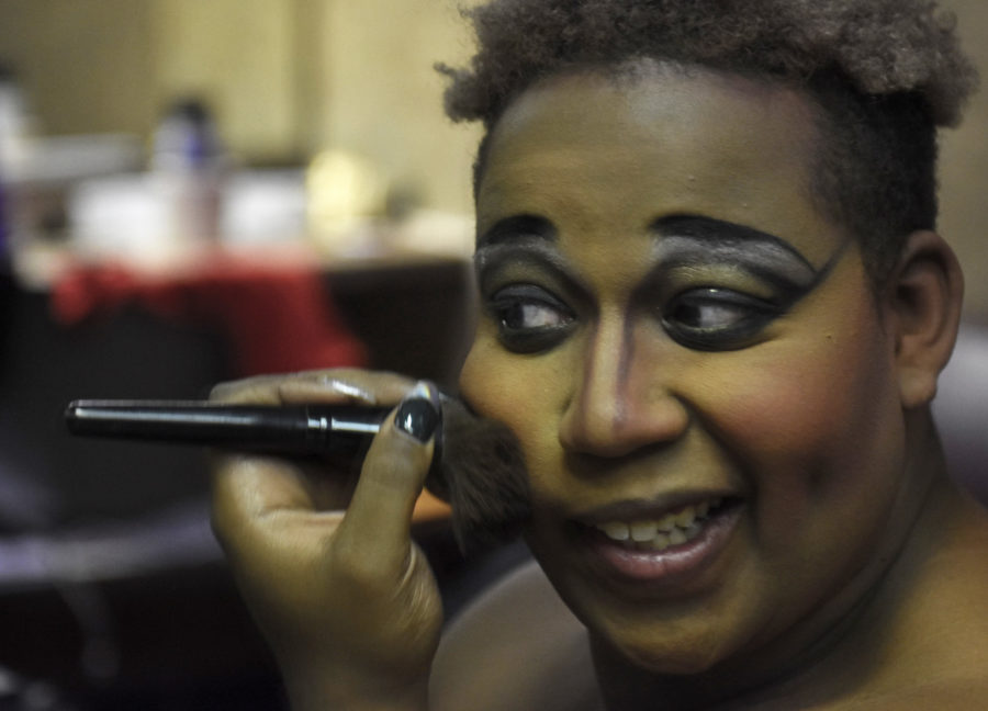 Da'Veon Burtin, a senior from Chicago studying theater, applies makeup Saturday, Feb. 25, 2017 before the start of the Golden Gays Drag show in the Student Center in which he performs under the name Rain Garnette Moore Foxx. (Anna Spoerre | @annaspoerre)