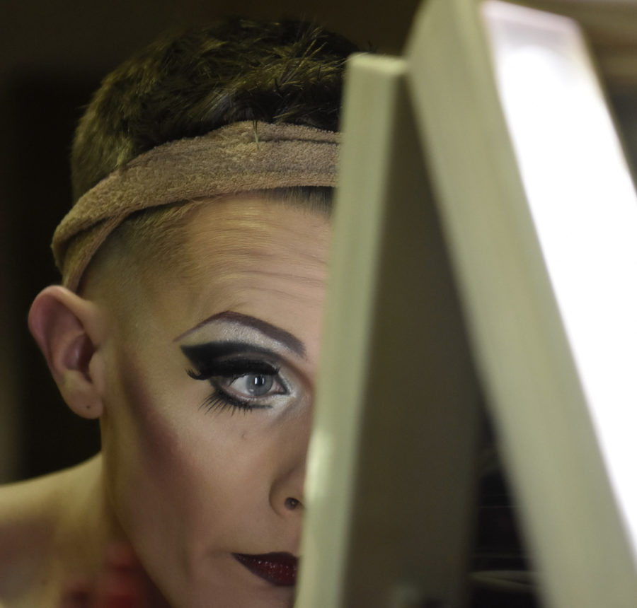 Jacob Hayes, who performs as Veronica, puts on makeup Friday, Feb. 25, 2017, before the Golden Gays Drag Show in the Student Center. (Anna Spoerre | @annaspoerre)