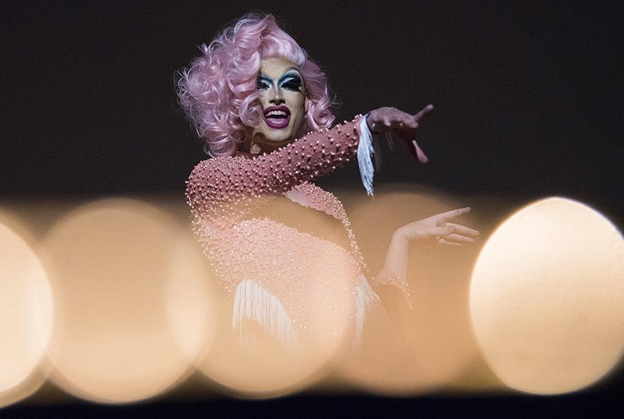 Peyton Kross, of Little Rock, Arkansas, points to the crowd while in the character of Lady Boi on Saturday, Feb. 25, 2017, during the Golden Gays Drag show in the Student Center.