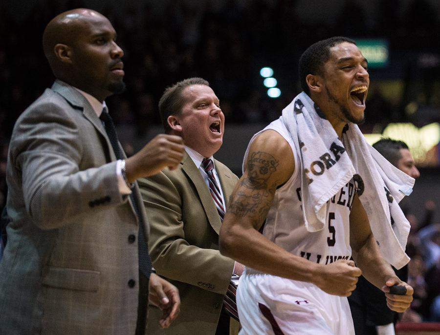 Assistant coaches Terrance McGee and Brad Autry and senior guard Leo Vincent celebrate near the conclusion of the Salukis' 72-70 win against the Loyola Ramblers on Saturday, Feb. 25, 2017, at SIU Arena. (Jacob Wiegand | @jawiegandphoto)