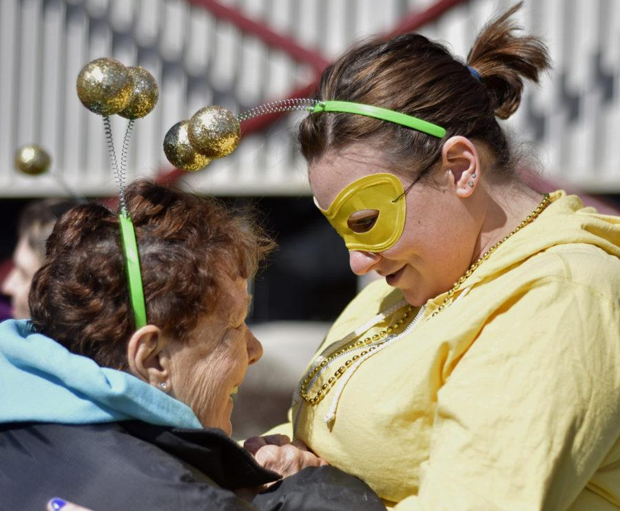 "Amber Neal, a qualified intellectual disabilities professional at Our Directions, embraces Roberta Dillon, a member of her Special Olympics team, the Honeybees, before the the Polar Plunge on Saturday, Feb. 25, 2017, at the Recreation Center. Neal said Roberta, 72, has been competing in Special Olympics events with her twin sister, Barbara Dillon, for the past 50 years. ""Special Olympics is probably the number one event they look forward to every year,"" Neal said. (Anna Spoerre 