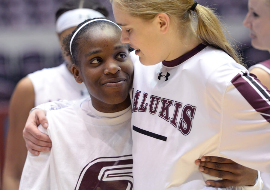 Senior point guard Rishonda Napier hugs freshman guard/forward Caitlyn Claussen on Sunday, Feb. 26, 2017, after SIU's 69-63 win over Bradley at SIU Arena. Napier was one of the team's seniors who were recognized after the last home game of the season. (Luke Nozicka | @lukenozicka)