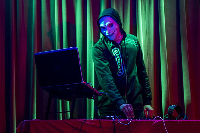 DJ Fac3 performs Thursday, Jan. 12, 2017, at Hangar 9 in Carbondale. DJ Fac3, a student studying biomedical science, keeps his identity hidden because he wants his audience to only focus on the music. (Branda Mitchell | @branda_mitchell)