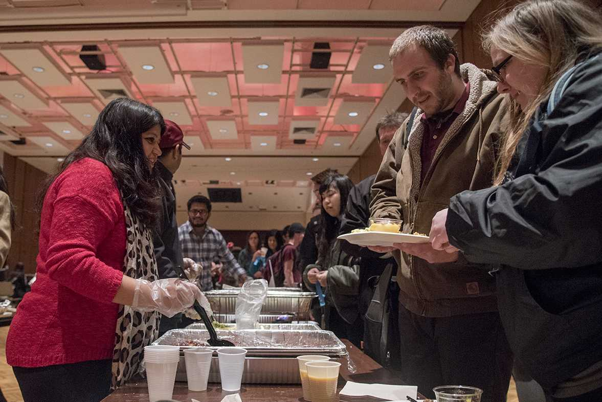 Erika Sharma, a community member working with the Nepalese Students Society, serves traditional Nepalese food Wednesday, Feb. 8, 2017, during the International Food Fair in the Student Center ballrooms. International Festival 2017 continues at 7 p.m. Friday with the Cultural Show in the Student Center ballrooms. (Branda Mitchell | @branda_mitchell)