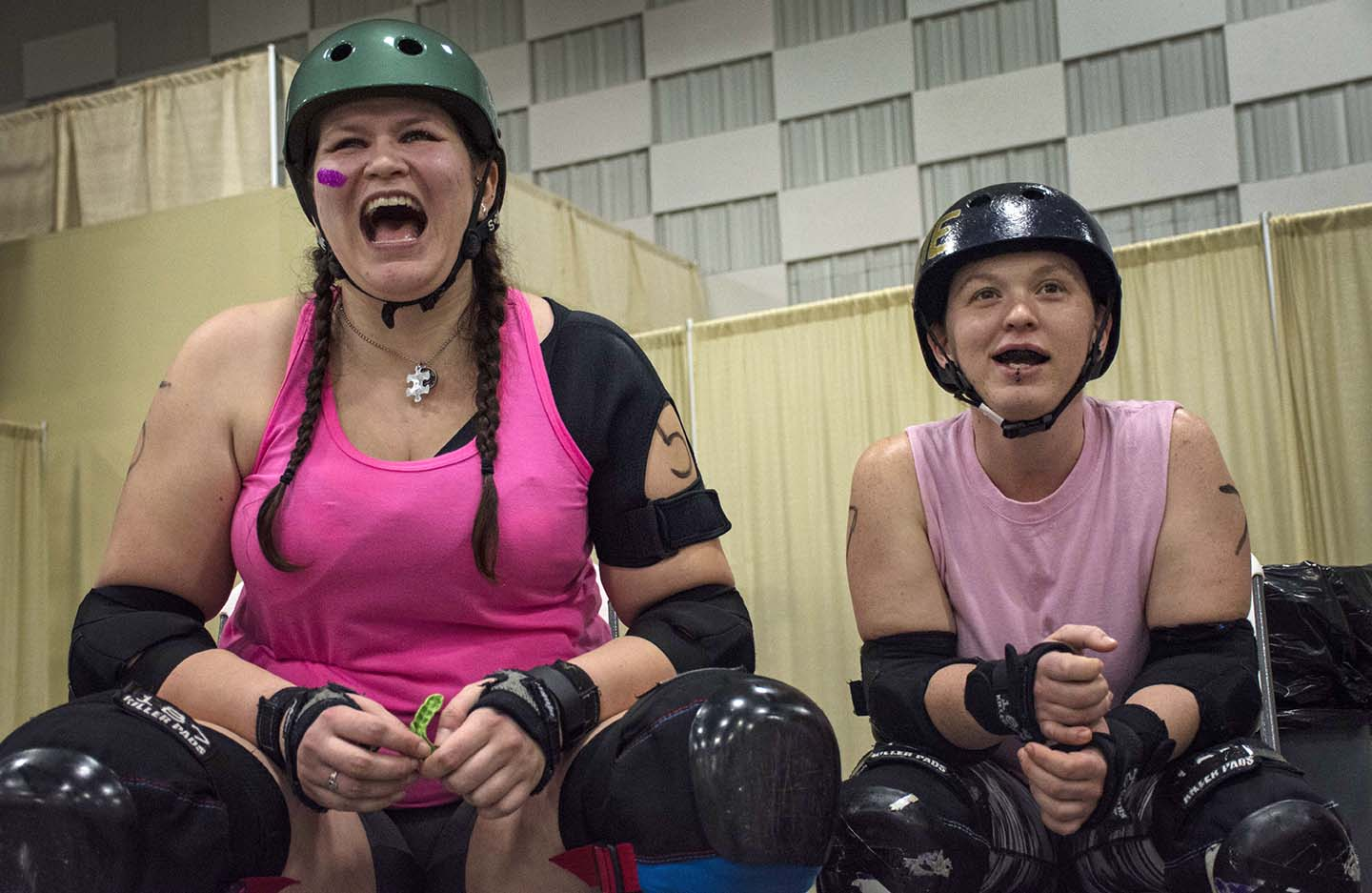 Britt Beiter and Searia Shappard, both of Murphysboro, react as their team the Bloody Roses scores a point Saturday, Feb. 18, 2017, in a co-ed scrimmage organized by the Southern llinois Roller Girls in The Pavilion of the City of Marion. (Athena Chrysanthou | @Chrysant1Athena)