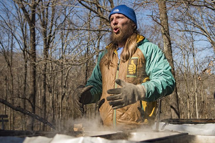 Isaac Taylor, a senior from Joliet studying recreation, explains the water evaporation process involved in making maple syrup Saturday, Feb. 25, 2017, at Touch of Nature Environmental Center in Carbondale. Staff at Touch tap trees, harvest sap and create maple syrup on site for the annual Maple Syrup Festival. (Branda Mitchell | @branda_mitchell)