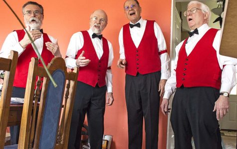 From left: members of the Little Egypt Barbershop Valentine's Day Quartet, Tom Smith, of Chester; Seth Hass, of Anna; Dennis Burd, of Carbondale; and Pat Kelley, of Carbondale, perform to Charles Schumann Jr. in his home Tuesday, Feb. 14, 2017, in Alto Pass. (Athena Chrysanthou  | @Chrysant1Athena)