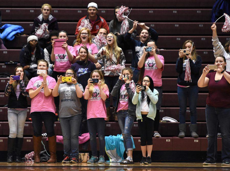 Members+of+the+Zeigler-Royalton+Junior+High+School+girl%27s+basketball+team+use+cellphones+to+record+their+teammates+participating+in+timeout+activities+Friday%2C+Feb.+3%2C+2017%2C+during+SIU%27s+71-60+loss+to+Drake+at+SIU+Arena.+%28Luke+Nozicka+%7C+%40lukenozicka%29