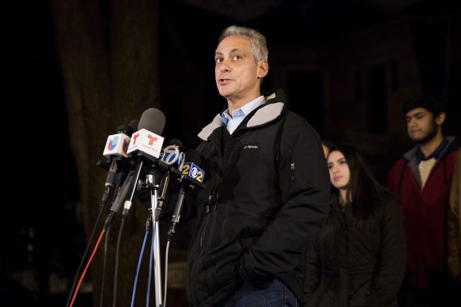 Mayor+Rahm+Emanuel+looks+at+a+group+of+protesters+that+interrupted+a+press+conference+in+front+of+his+home+after+the+mayor+hosted+a+dinner+with+immigrant+students+Tuesday%2C+Jan.+31%2C+2017+in+Chicago%2C+IL.