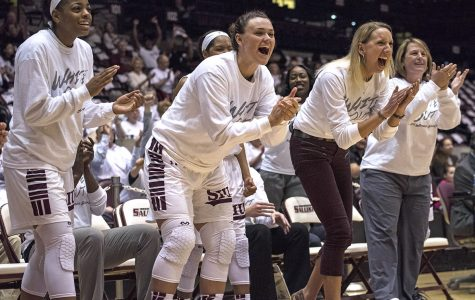 Members of the Saluki women's basketball team celebrate after a basket Sunday, Feb. 5, 2017, during SIU's 64-59 win against Northern Iowa at SIU Arena. (Athena Chrysanthou | @Chrysant1Athena)