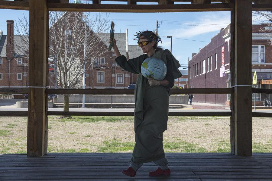 """Deborah Bouton, dressed as Lady Liberty, attends the """"A Day Without a Woman"""" rally Wednesday, March 8, 2017, in the Carbondale Town Square Pavilion. She said holding the globe upside down is metaphor for the country. """"The globe is 80 percent water,"""" she said. """"And when a diver is in distress, the boat will fly the flag upside down."""" (Branda Mitchell 