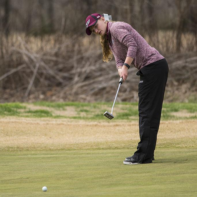 Freshman Erica Kerr putts the ball Sunday, March 26, 2017, during the Saluki Invitational at Hickory Ridge Golf Course in Carbondale. The Salukis led the tournament after the first day. (Branda Mitchell | @branda_mitchell)