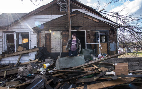 India Marsh surveys the destruction of her Elkville home Wednesday, March 1, 2017, after a tornado ripped through the town and several surrounding southern Illinois communities Tuesday night. Marsh said she has lived in the house her whole life.